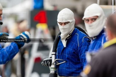 The eyes - The fact that the fire restardent balaclava covers this crew members face, leaving only his eyes visible give it so much impact, and makes the intense look of concentration very prominent, the narrow depth of field almost guiding your own eyes directly to his own.