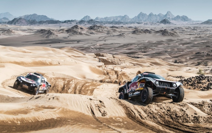 The Mini teammates headed to the finish line in formation on 2021 Dakar Stage 12