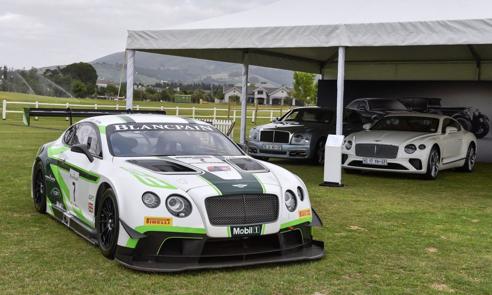 A Bentley Continental GT3 racecar (front) and its roadgoing siblings in the background