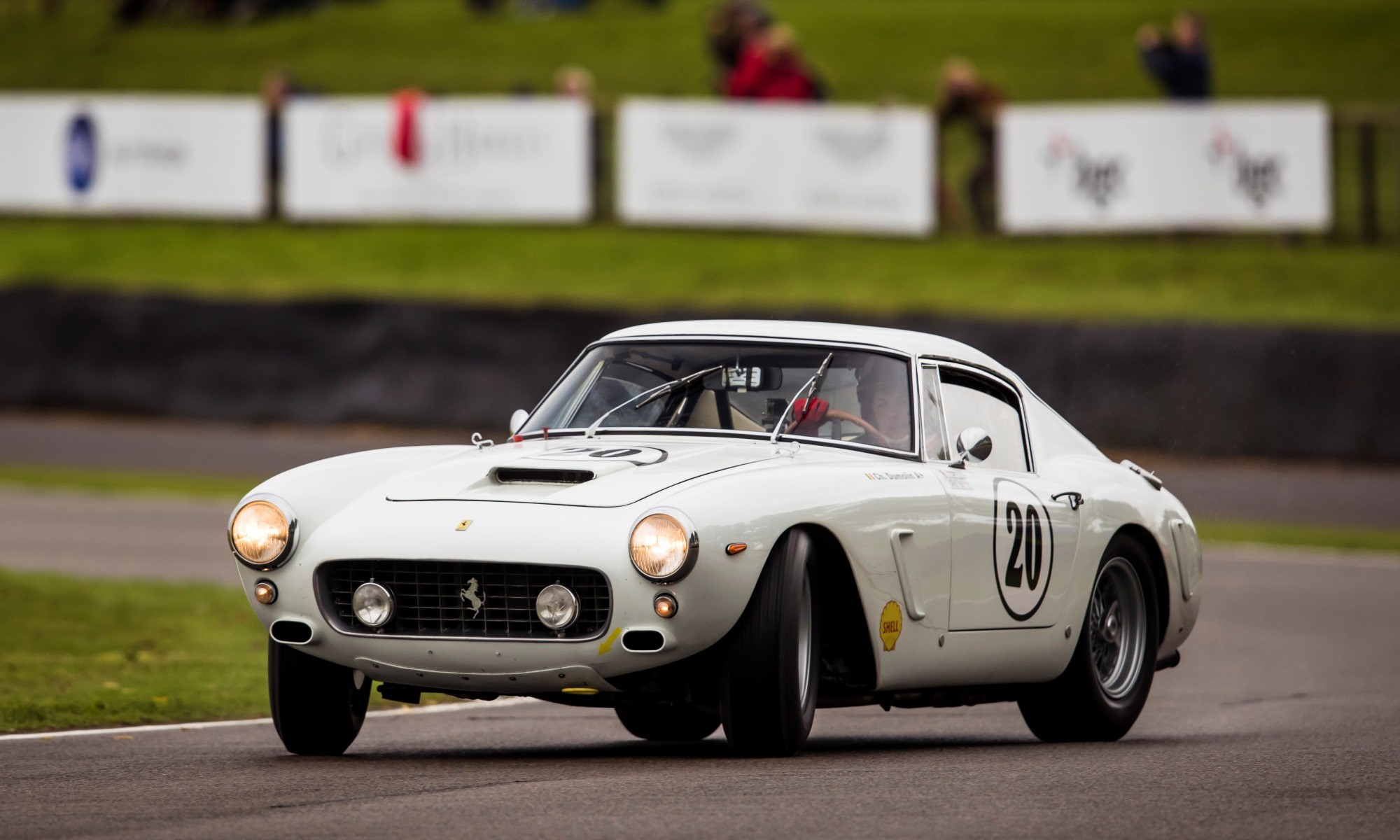 A Ferrari 250 GT SWB being driven on the absolute limit