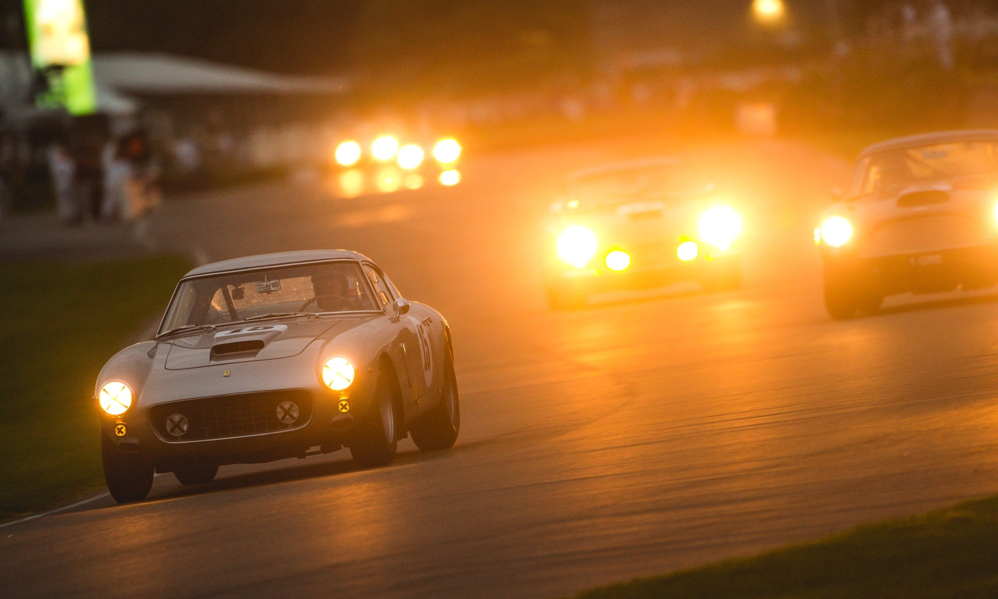 A Ferrari 250 GT SWB is chased by an Aston Martin DB4 GT at the most expensive motor race