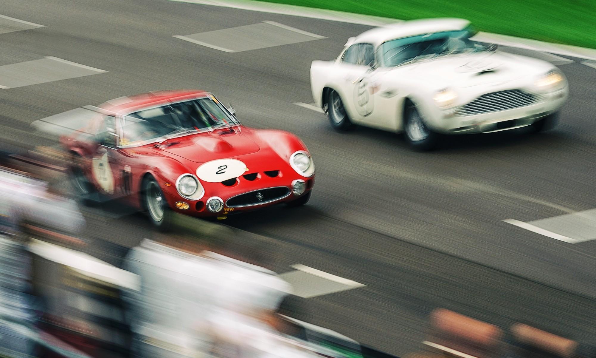 A Ferrari 250 GTO overtakes an Aston Martin DB4 GT
