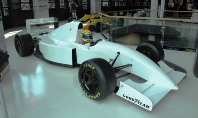 A Lamboghini powered F1 car with a famous helmet in the cockpit