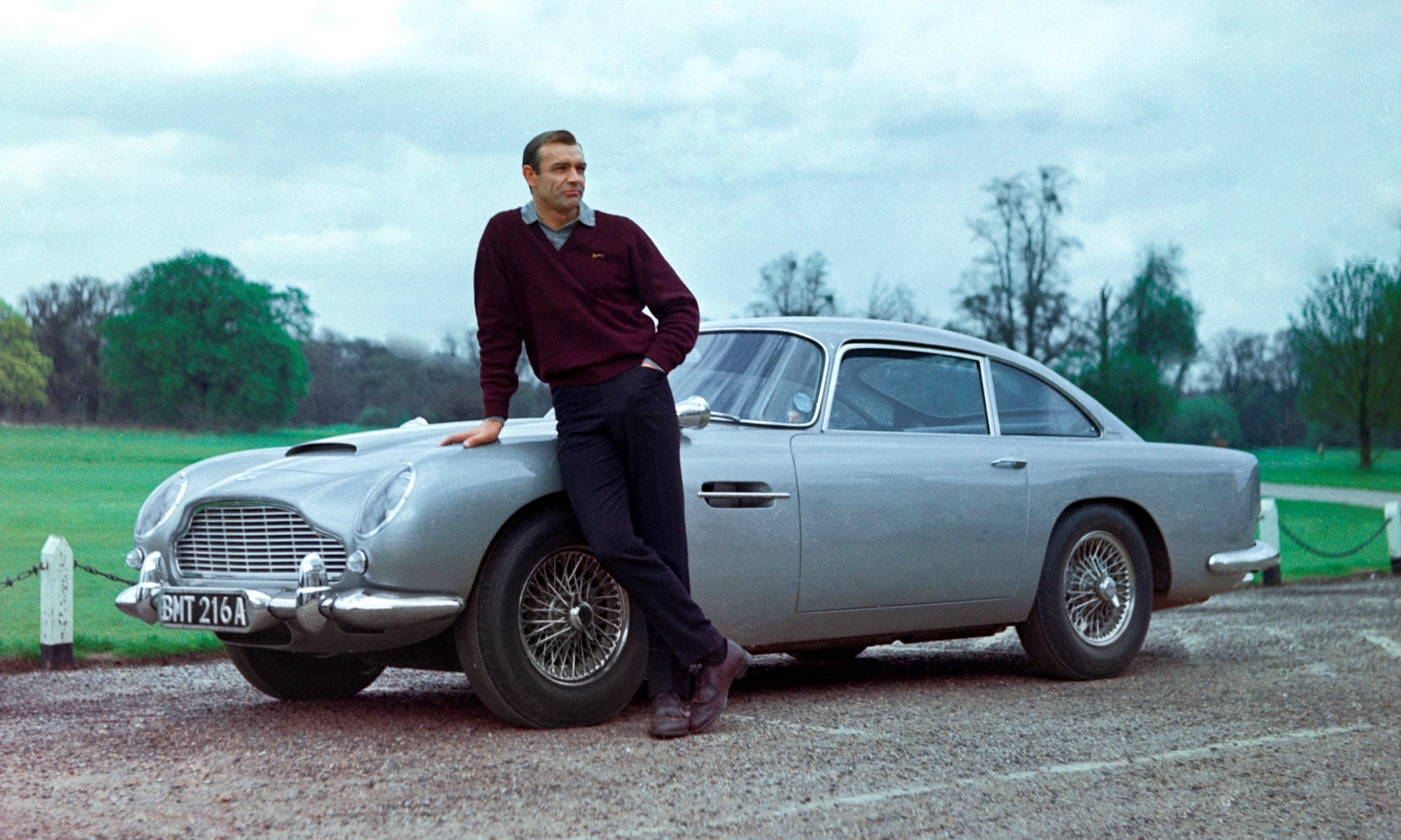 Sean Connery as James Bond with the famous Aston Martin