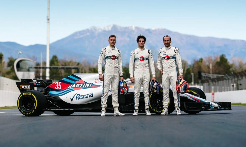 Canadian driver Lance Stroll (centre) has not had a great season thus far
