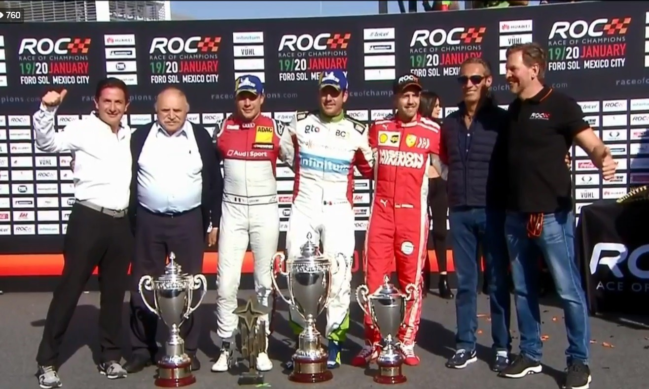Guerra flanked by Duval and Vettel along with race officials