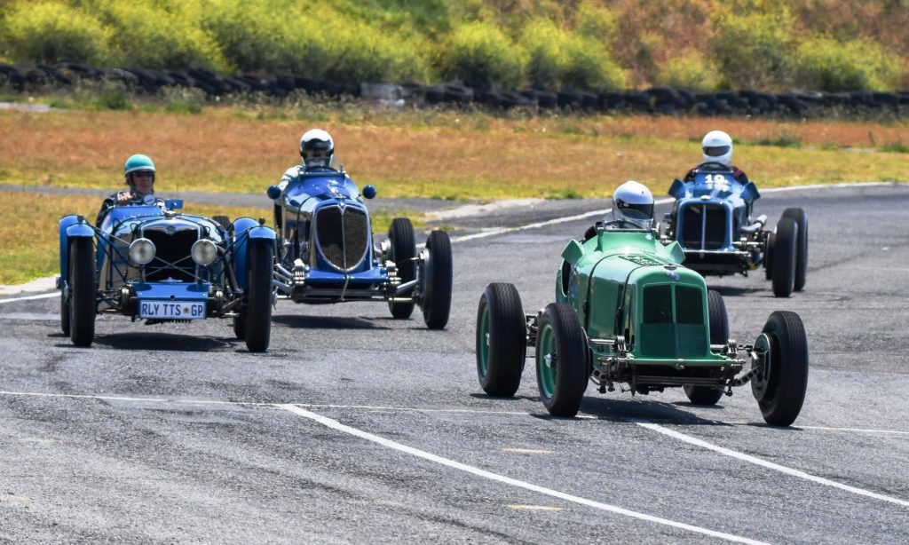 Old racers tearing around the track