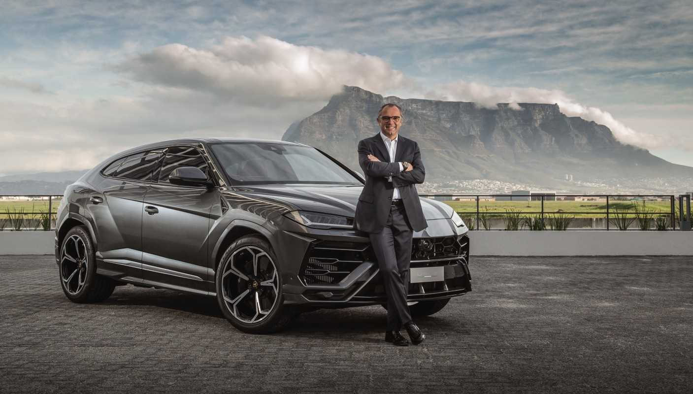 Lamborghini chairman and CEO Stefano Domenicali with the Urus, set against the backdrop of Table Mountain.