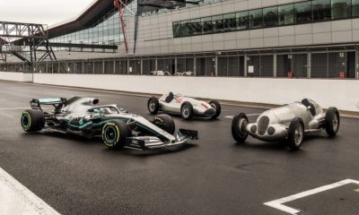 Modern day F1 car with its predecessors