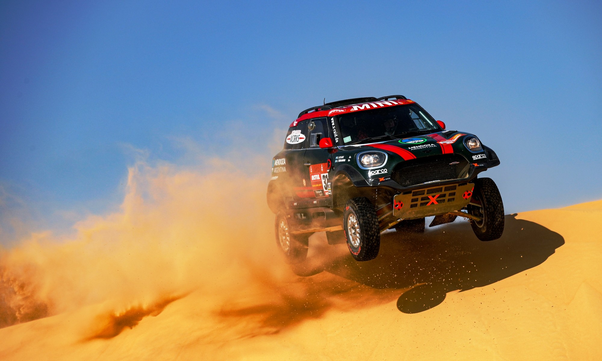 Orlando Terranova and Bernardo Graue in the John Cooper Works X-Raid Mini smash over a dune during Stage 10 between Haradh and Shubaytah (Photo by Florent Gooden for DPPI)