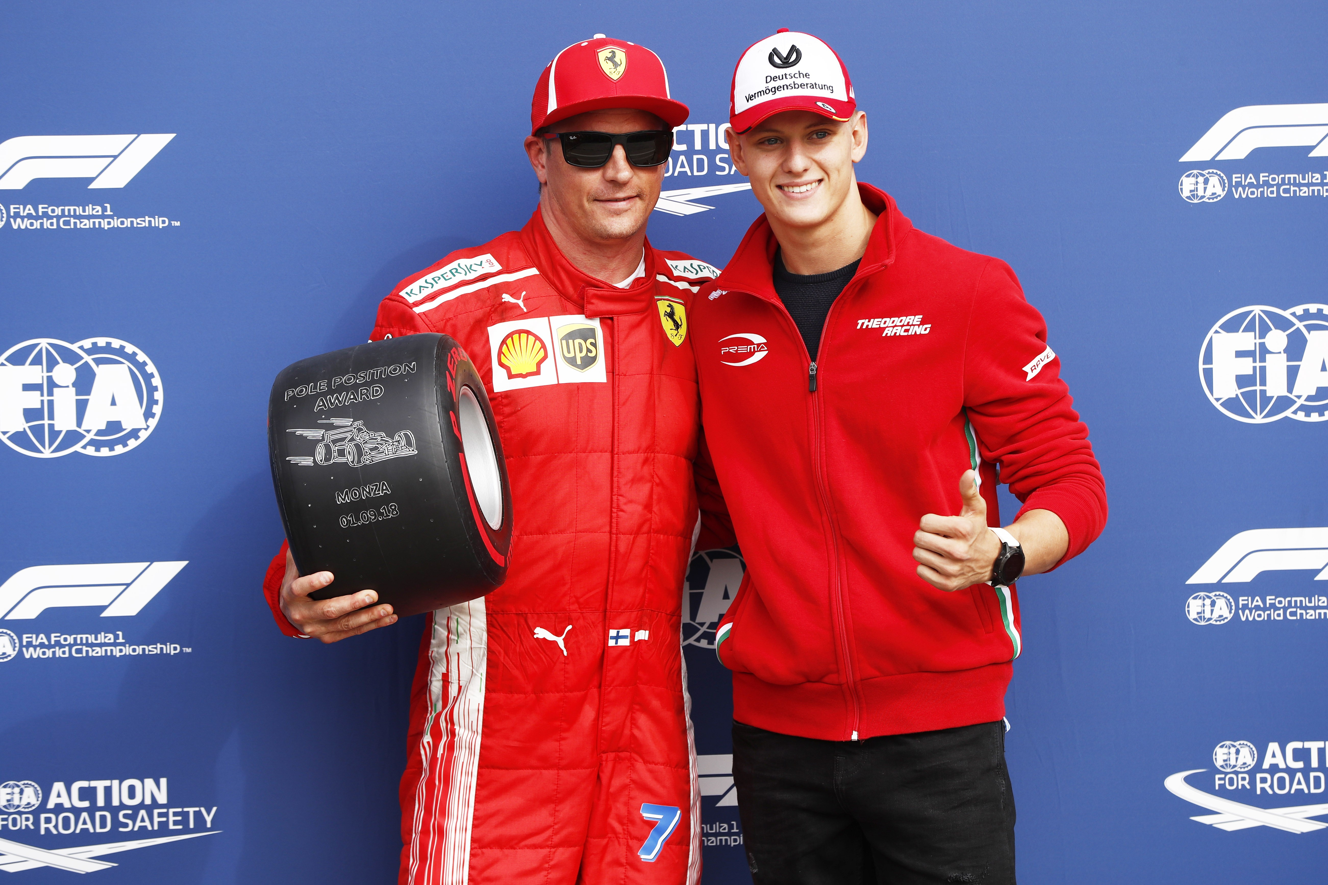 Pole sitter Kimi Raikkonen with Mick Schumacher
