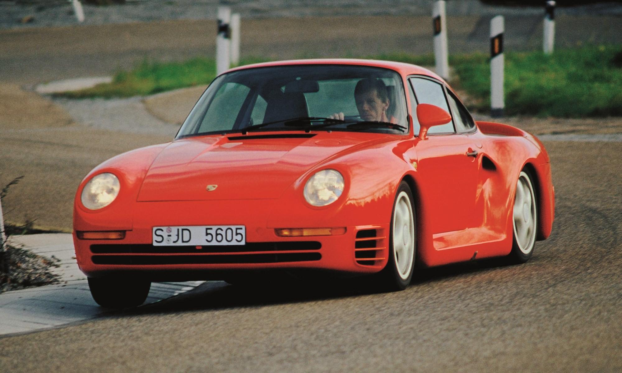 Porsche brand ambassador and test drive Walter Rohrl hustles a 959