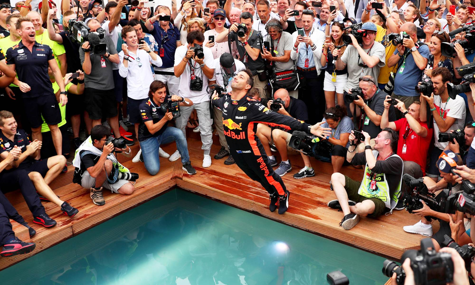The Aussie driver celebrated his win by taking a dip