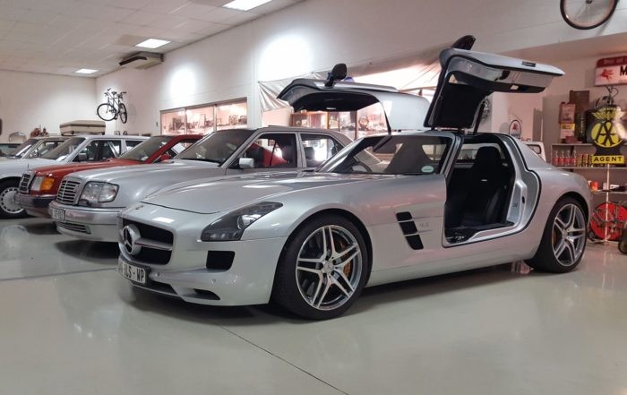 The SLS AMG aka the modern Gullwing in look-at-me 'wings' up pose, is the youngest car in the Mercseum.