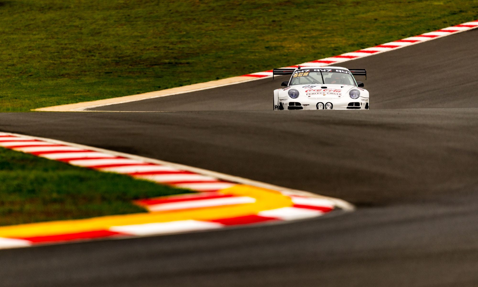 The Team Perfect Circle Porsche negotiates the lowest part of the track (image by David Marchio)
