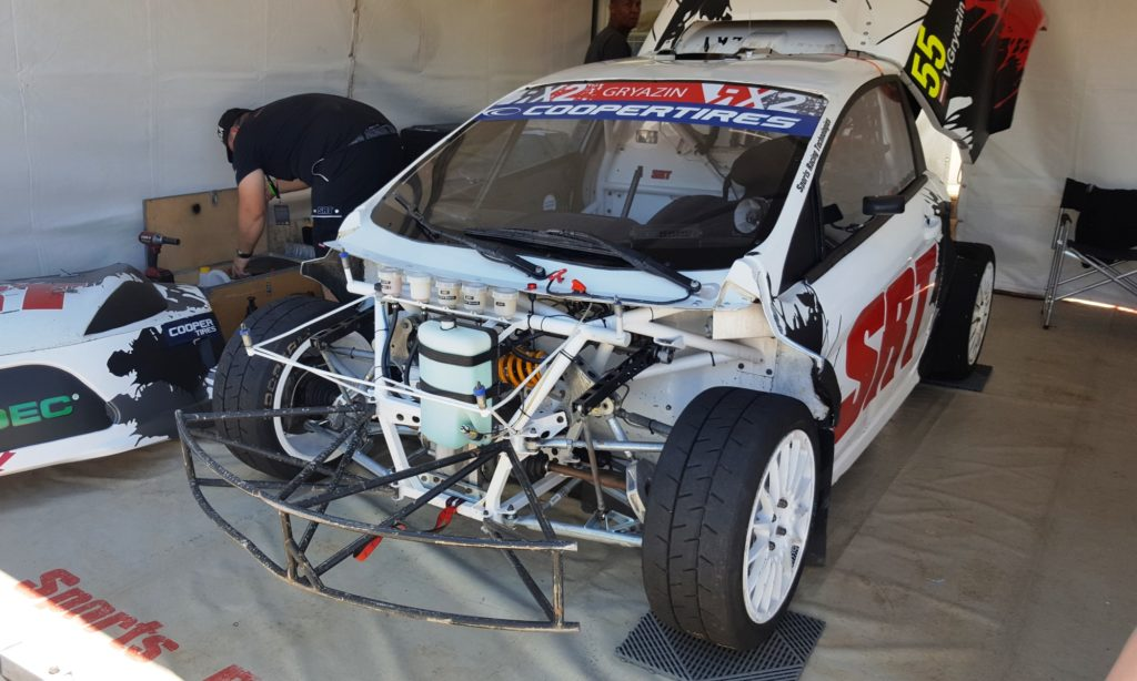 The simple, yet beefy front suspension of an RX2 car.