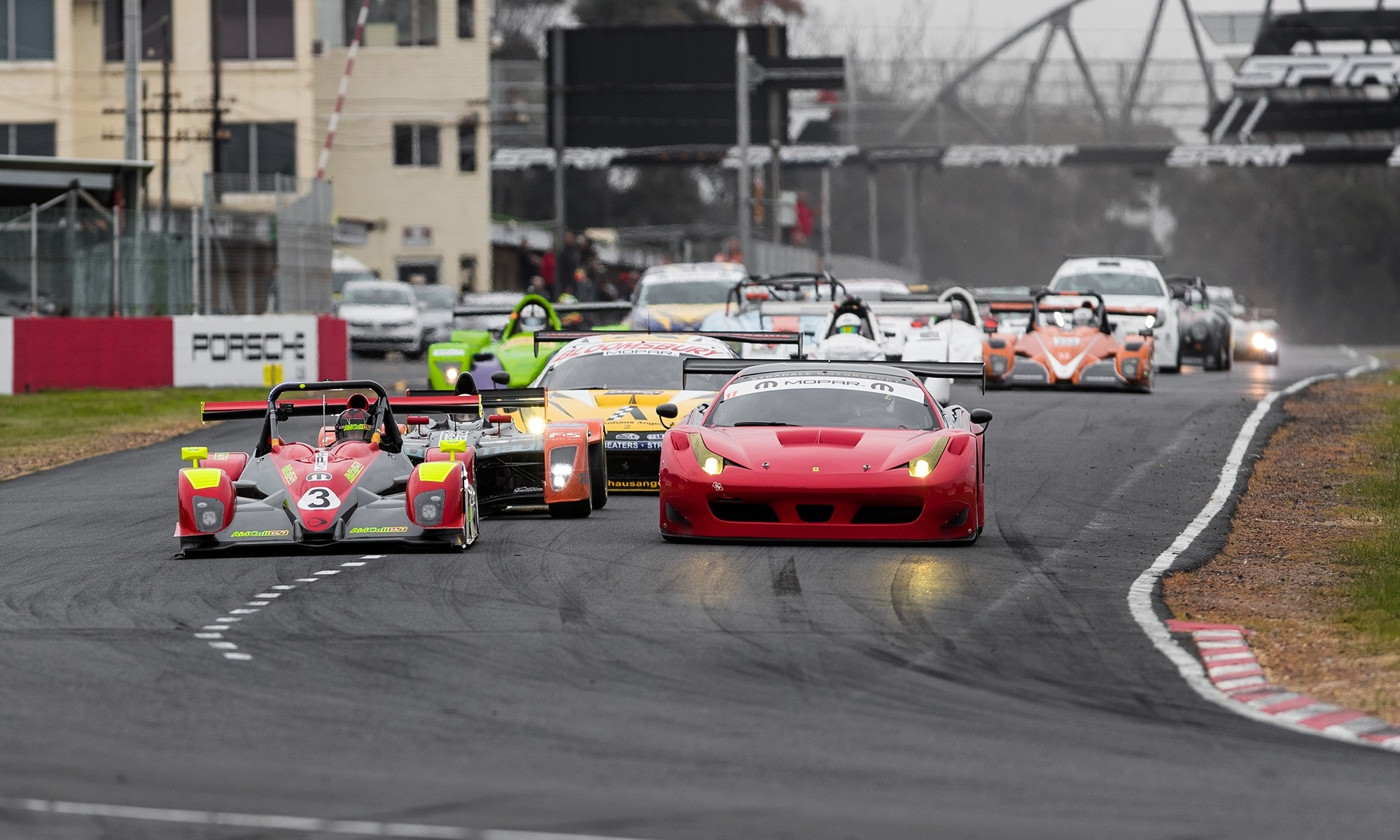 The varied field bunched up at the start of the SA Endurance Series Campos 600. Leading the charge are a Ligier (left) and Ferrari 458 GT3.
