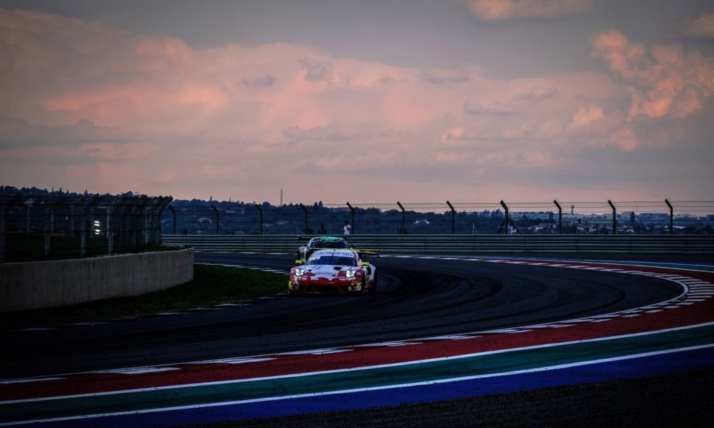 The Porsche 911 GT3 R through the famous Sunset corner at sunset during Friday practice