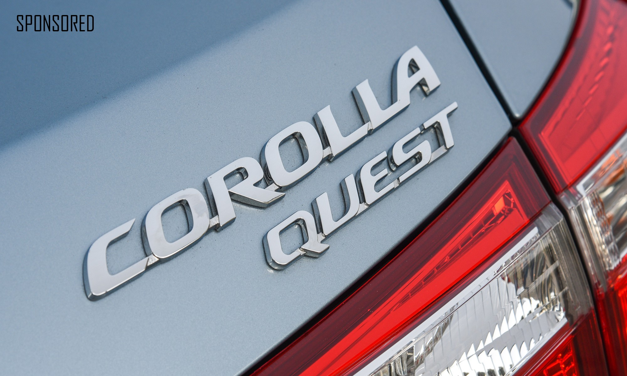Toyota Corolla Quest badge sponsored