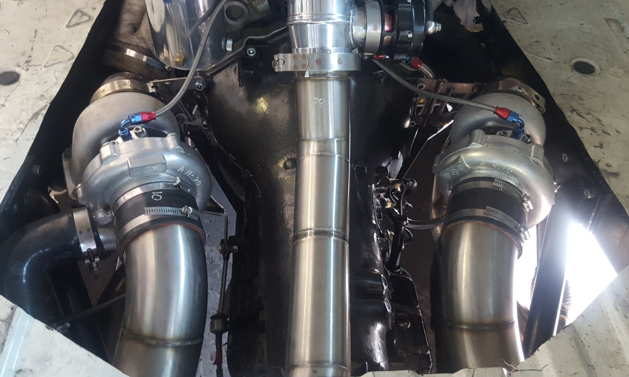 Two turbochargers feed the V12 motor